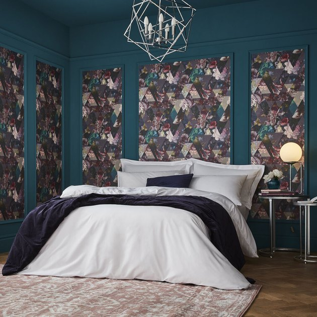 bedroom with teal wall and floral wallpaper