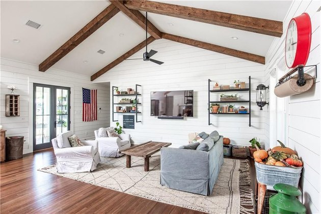 farmhouse living room interior with wooden beams and white walls