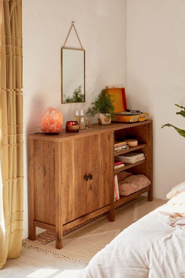 A skinny wood media stand