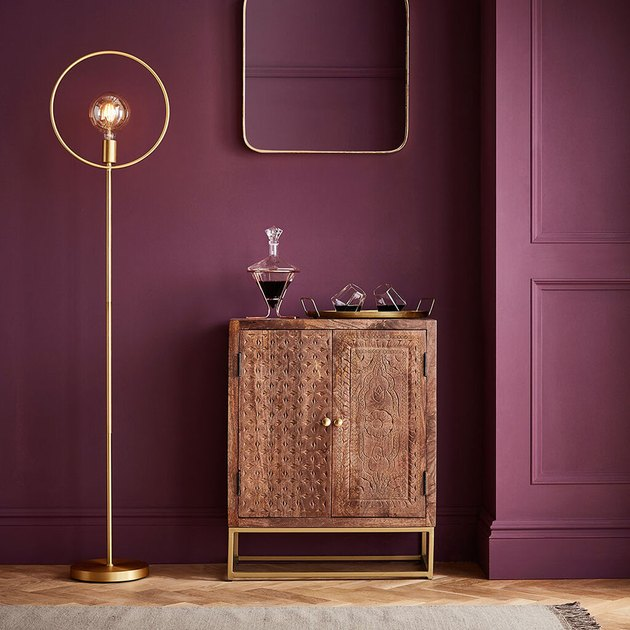mauve room with wood furniture