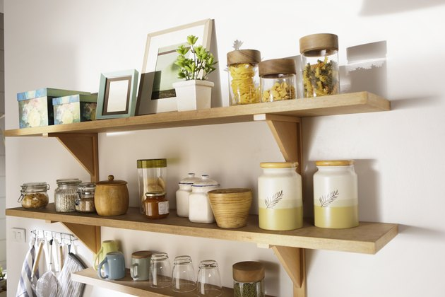 wooden shelf and containers on the wall
