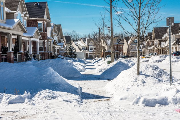 Sidewalks near houses cleared of snow by residents