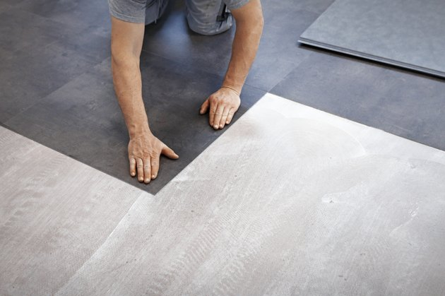 Worker making vinyl flooring