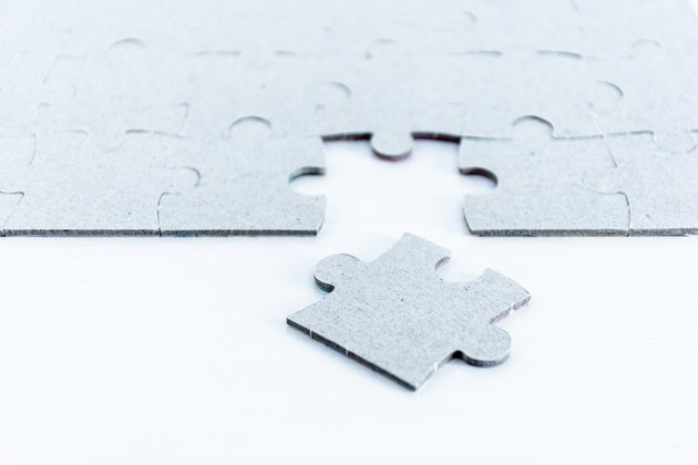 Gray puzzle pieces on white background