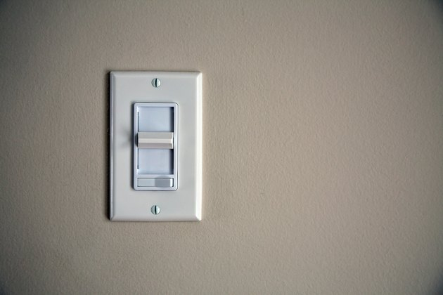 Contemporary dimmer switch on wall