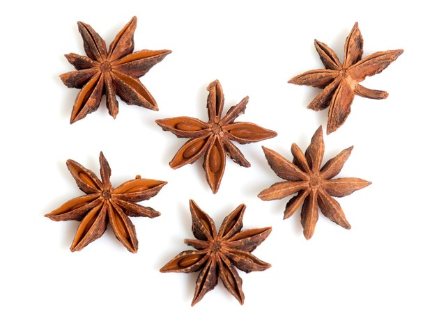 Close-Up Of Star Anise Over White Background
