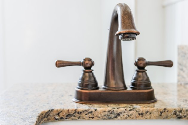 Bronze bathroom vanity faucet and sink