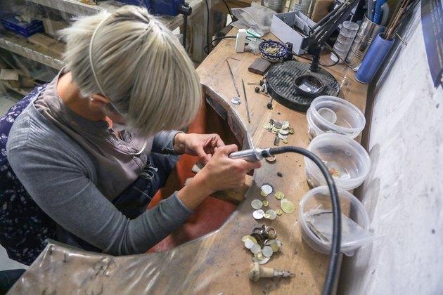 A jewelry designer working in her studio.