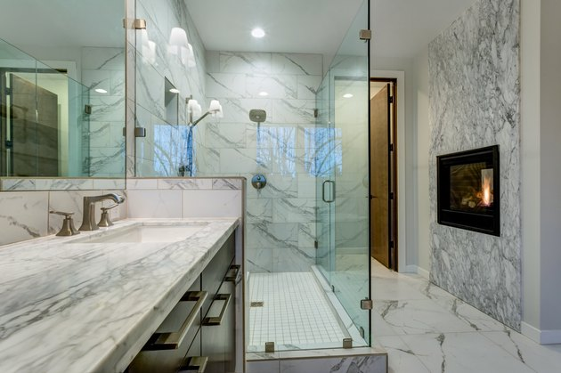 Incredible marble bathroom with fireplace.