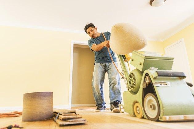 Man refinishing floors.