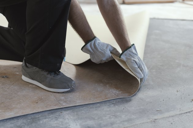 Contractor removing an old linoleum flooring