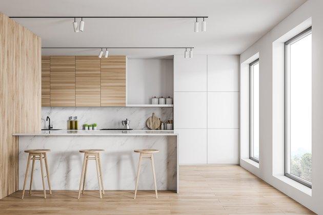 Loft kitchen interior with marble bar