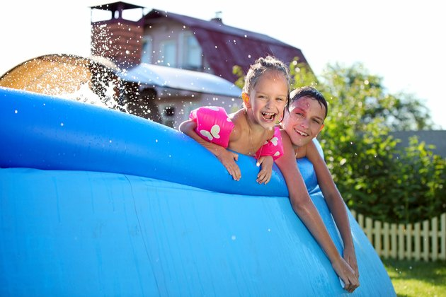 Kids having fun in a inflatable swimming pool