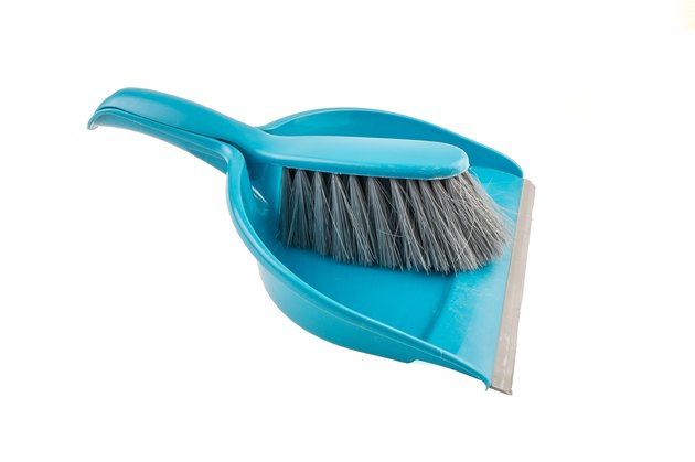 Blue dustpan and a brush.