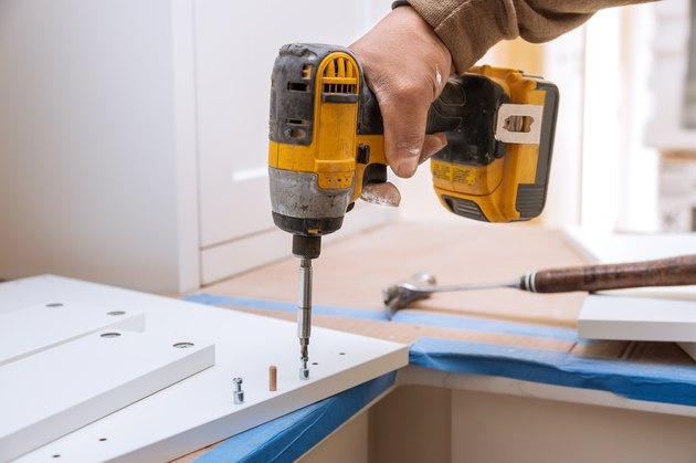 Cropped Hand Of Man Working With Drill On Wood