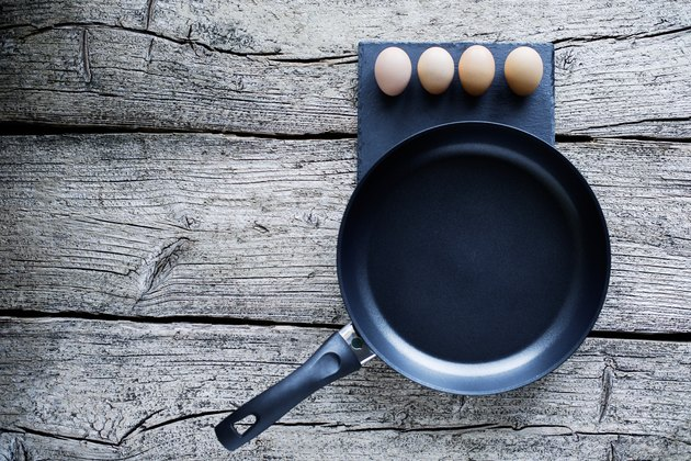 Cooking eggs on a frying pan