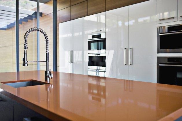 Interior of modern kitchen with spray nozzle