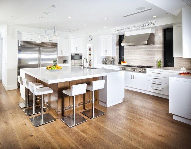 White kitchen with hardwood floor