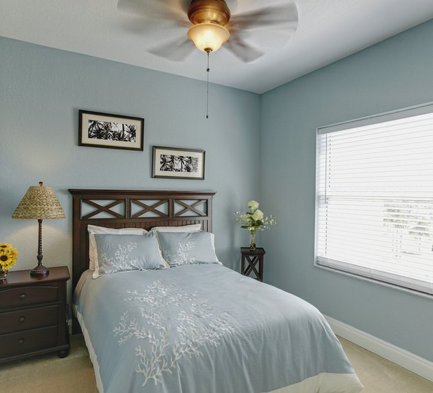 Ceiling fan over bed in bedroom.