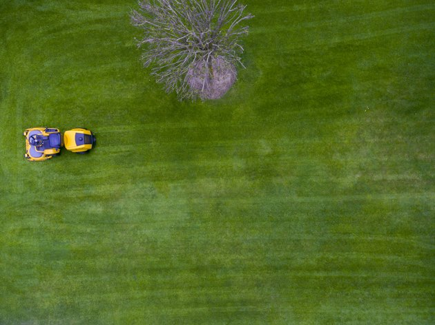 Aerial view of lawn tractor or riding mower. Directly above. Drone view.