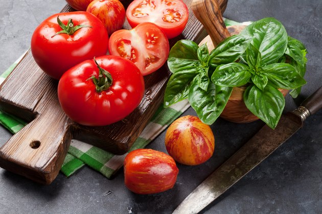 Fresh ripe garden tomatoes and basil.