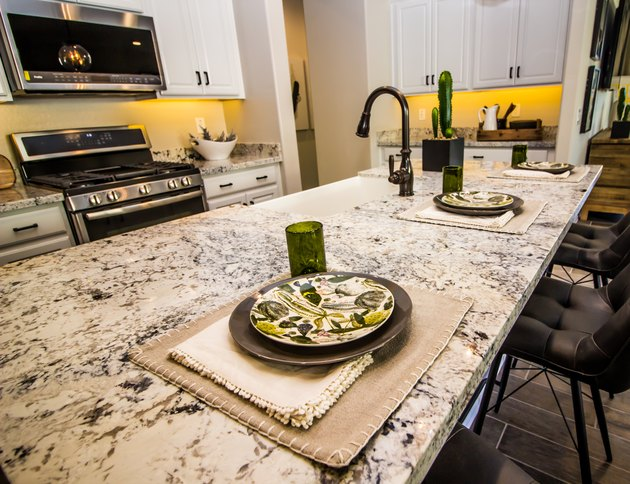 Granite Counter Top With Three Place Settings