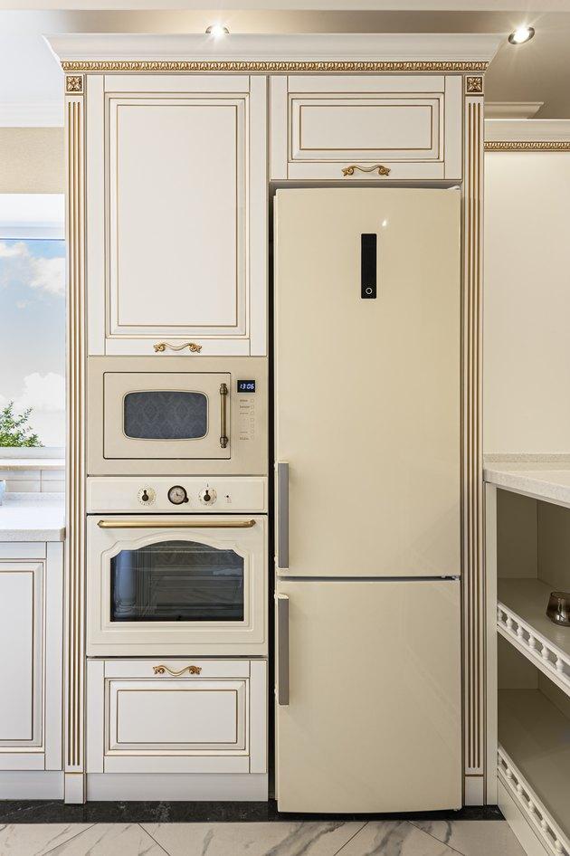 Neoclassic-style luxury kitchen interior with island