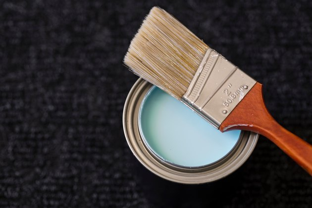 Close-Up Of Paintbrush On Paint Can At Table