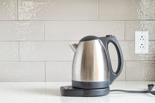 Electric stainless steel kettle on a granite counter top