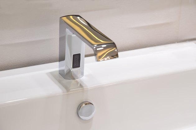 Bathroom faucet in polished chrome powered automatic by sensor. object about home Improvement.