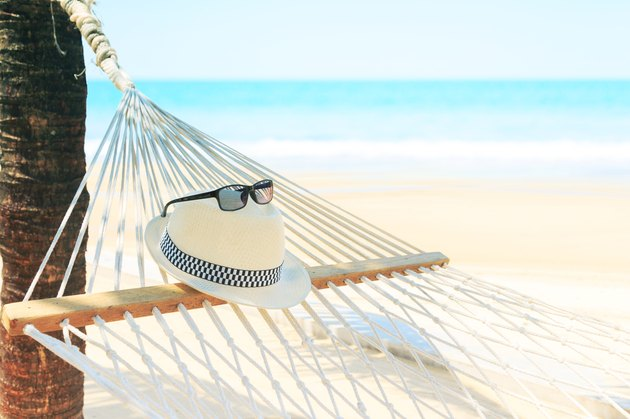White hat and sunglasses with hammock on beach view summer