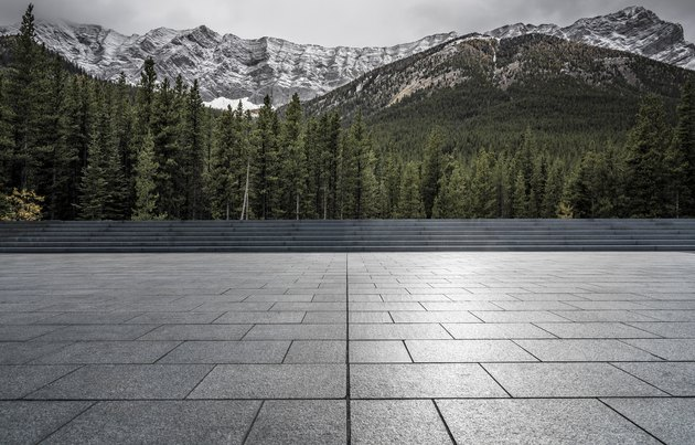 Empty patio front of forests and mountains