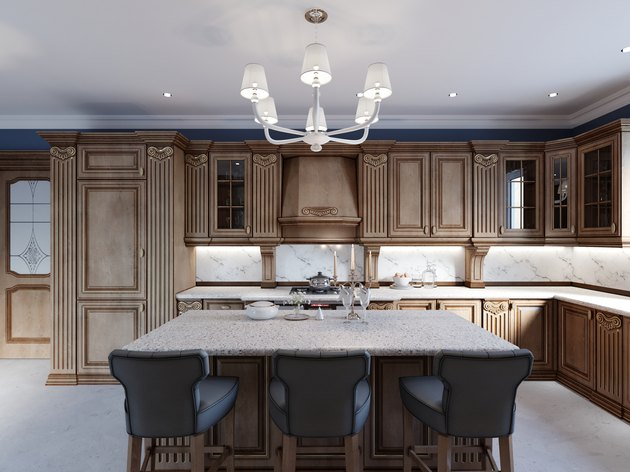 Cherry furniture kitchen island details and bar chairs.