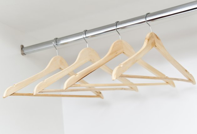 Wooden hangers on a rod (Click for more)