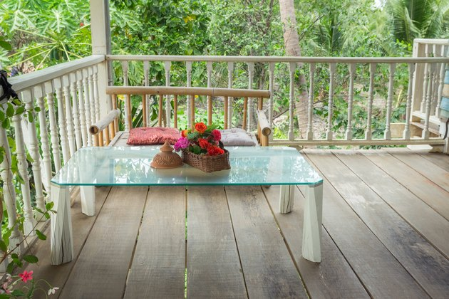 Thai-style seating on balcony in garden house