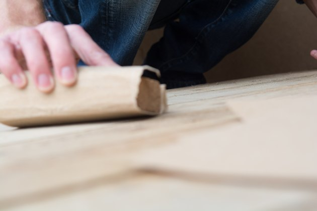 Carpenter working with wooden boards