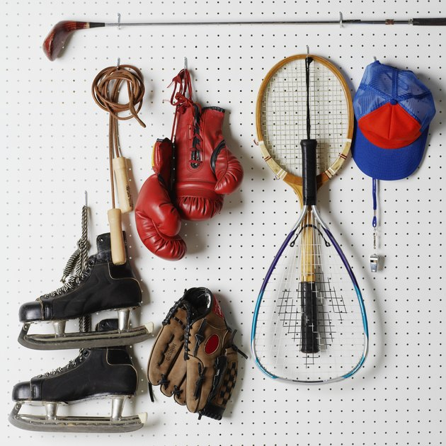 Sports Equipment hanging from pegboard.