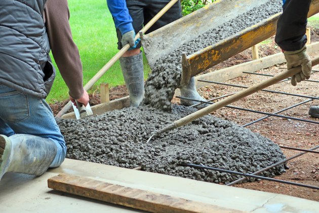 Make a concrete driveway- fresh cement from truck and workers