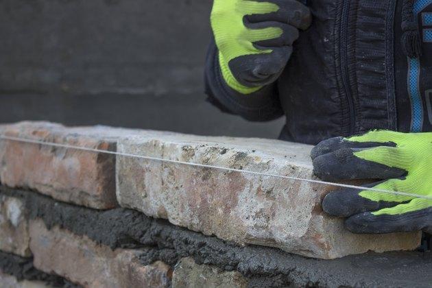 Installing brick, build a brick wall