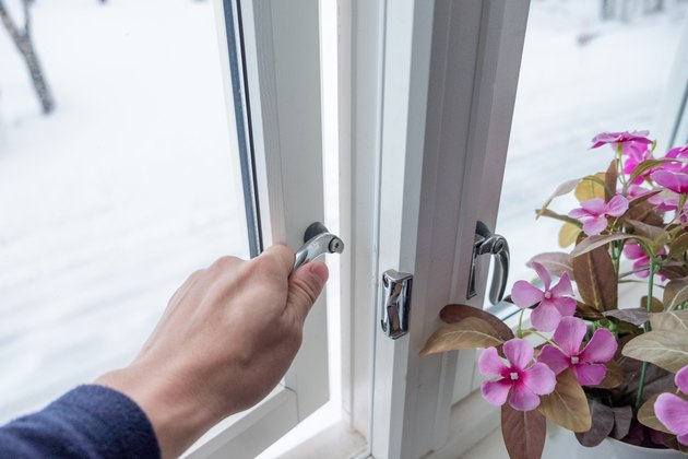 Hand opening window with flower decoration.