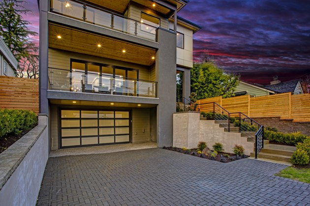 Luxury modern home exterior at sunset