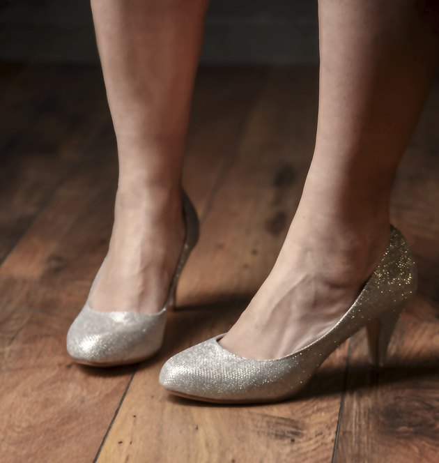Woman's foot in high heels shiny shoes