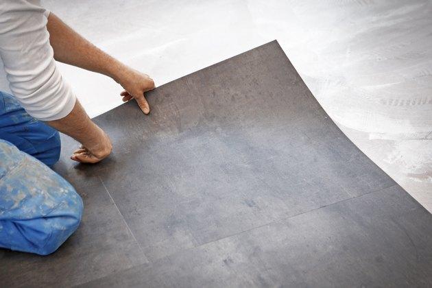 Worker making vinyl flooring