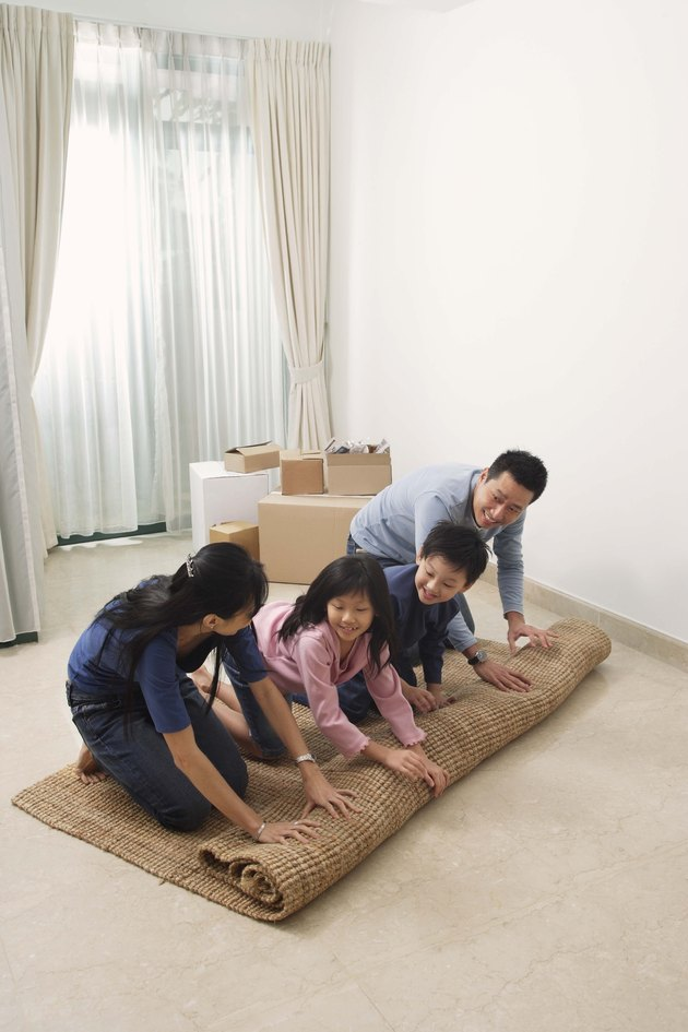 Family unrolling rug