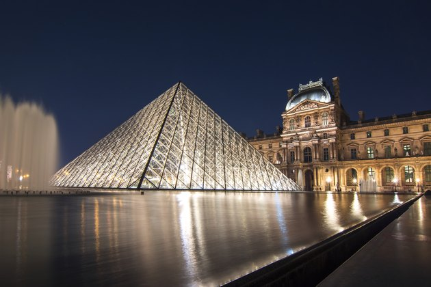 Louvre palace and pyramids at night, Paris, France