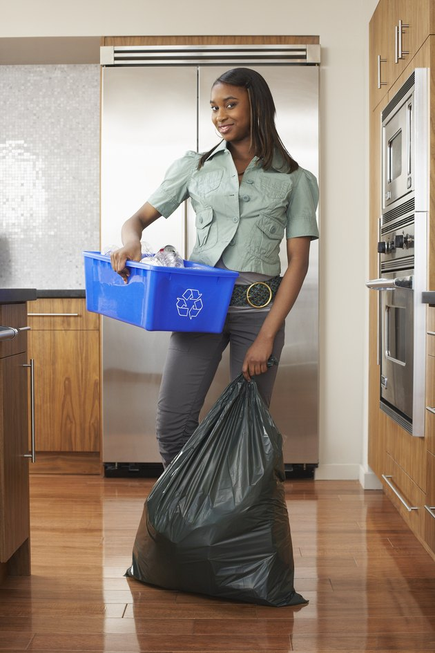 Woman with Recycling Bin and Garbage Bag