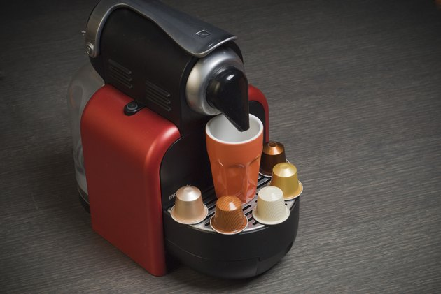 Nespresso coffee machine with capsules and cup