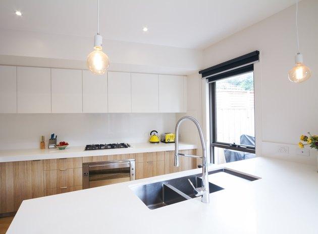 Modern kitchen with pendant lighting and sunken sink