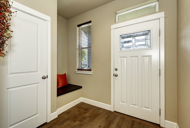 Empty brown entryway interior with white doors
