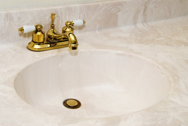 Cultured Marble Sink with Gold Faucet